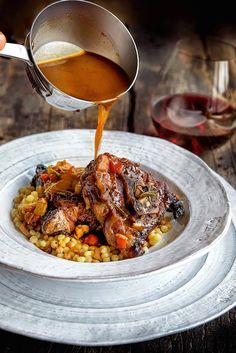 Slow cooked lamb doused in a scrumptious sauce, that has been reduced is served over fregola sarda to soak up the flavors and brightened with lemon slices.