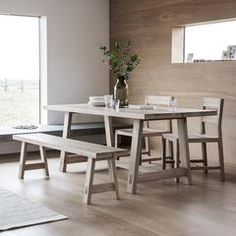 This dining table fuses the outdoors and indoors with its picnic-style construction. Set on two sets of triangular legs, this table is not only a gorgeous example of sleek design, it is also sturdy and ready for your family to gather around it. Pair it with the Kielder benches, chairs, or a combination of both.  Match with other items in the Kielder Range.  The new Kielder solid oak furniture range from Hudson Living is a minimalist range, which offers a contemporary and fresh design. Constr