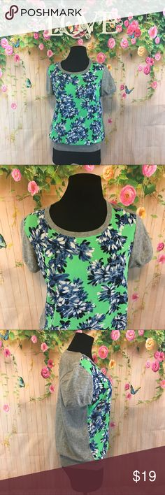 J. Crew floral print blouse with sweater back Nice blouse very pretty bright colors in the front with a sweater back in good condition 100% cotton J. Crew Tops Blouses