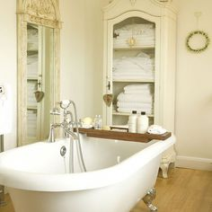 French-inspired Bathrooms .....THE OFF WHITE DISTESSED FRENCH MIRROR AND CABINET ARE BEAUTIFUL,GREAT IDEA FOR THIS FRENCH STYLED BATHROOM!!! 'Cherie