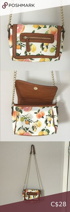 Aldo Citrus Fruit Purse Used Aldo cross-body bag. The only defect is a slight blue grey stain that is visible in the second photo only when you open the purse. Great accessory for summer time! Aldo Bags, Grey Stain, Summer Time, Cross Body, Blue Grey, Crossbody Bags, Two By Two, Purses, Fruit