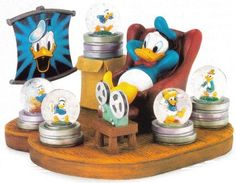 Disney Donald Duck Through The Years Snowglobe