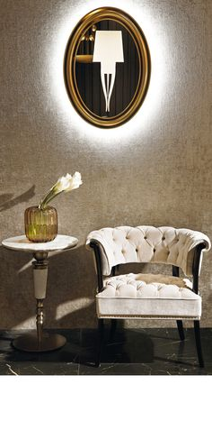 Luxury armchair. neutral colors armchair. Round mirror. Luxury furniture. Interior design, interiors, decor. Take a look at: www.bocadolobo.com