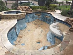 """Our display pool at our corporate office in Murphy getting a facelift with new waterline tile, our new standard Globrite lights, and our new exclusive plaster color """"Driftwood"""" made exclusively for Hobert Pools!"""