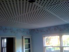 Interesting idea...Lattice ceiling for unfinished basement.    Maybe on concrete walls?