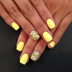 It is sensual and exciting manicure. Delicate yellow varnish creates a sunny mood of all around. A single nail, decorated with shiny rhinestones creates a