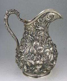 "Schofield Co. ""Baltimore Rose"" high relief repousse sterling silver water pitcher, Baltimore (Britannia Silver) Like the shape Silver Trays, Silver Spoons, Vintage Silver, Antique Silver, Silver Water, Bronze, Silver Necklaces, Silver Earrings, Calla Lilies"