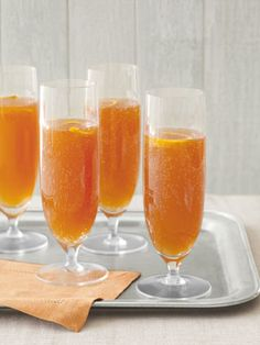 Country Living's Orange-Cherry Champagne Cocktail. This would be fabulous on New Years Eve! #NewYears #NewYearsEve #recipe #Holiday #Dinner