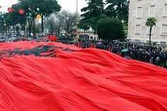 Supporters of the Albanian Red and Black Alliance party hold an Albanian national flag as they protest in front of the Albanian Prime Ministers office in Tirana.