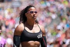 2. Elisabeth Akinwale  In the last decade crossfit has become a favorite workout of fitness buffs around the country; however, few are fit enough to participate in the Crossfit Games. Elisabeth Akinwale is one of those few. She has competed in the Crossfit Games twice finishing 13th in 2011 and then upping her game to finish 7th in 2012. A quick glance at her blog shows the beautiful Akinwale and her gorgeous curls are training hardcore and likely to compete in next year's games.