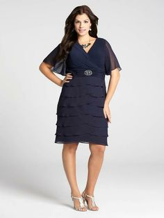 Laura Plus: for women size 14 . Navy blue is a great alternative to black when dressing for an evening event. This beautiful dress boasts a ruched waist accented by a crystal buckle, a tiered skirt and elegant flutter sleeves, making for a...5030103-8305