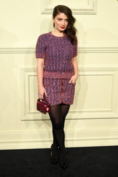 Eve Hewson at the Chanel Paris-Salzburg show in NYC wearing a tweed top and skirt with tights