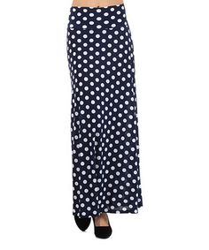 Step up in sweeping style with this maxi skirt that features a snazzy print on a classically beautiful form. A classic silhouette always keeps spirits high and comfort in check.