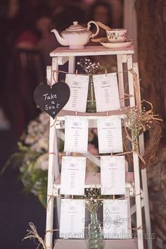 Retro wooden step ladder wedding table plan at barn wedding venue. Photography by one thousand words wedding photographers