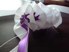 sewing two ribbons together to make a ribbon lei