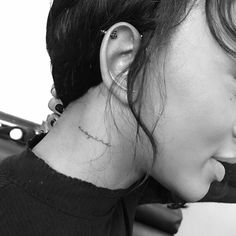"""""""Respire"""" tattoo on Elisa Johnson's right side of the neck."""