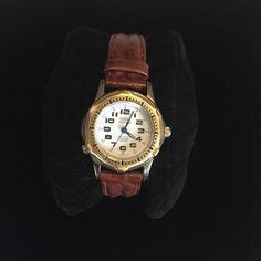 Illuminated leather band watch Guess watch. Silver/gold detail with leather band. Illuminated. Needs battery Guess Jewelry