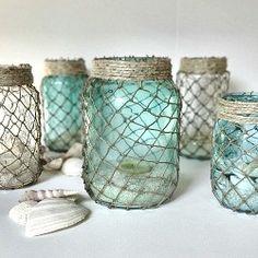Wrap mason type jars with fisherman's netting for coastal or nautical inspired decor.