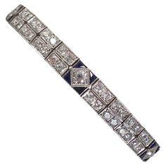 Sapphire Diamond Platinum Double Straightline Flexible Bracelet. Art Deco Platinum & Diamond, Sapphire Double Straightline Flexible Bracelet Consisting Of 7 Carats of old mine cut diamonds and 1 carat of custom Art Deco Cut Sapphires. Beautiful Blue Color. Made in the 1920s in America. 1920s