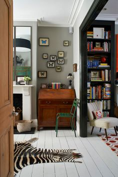 Lessons in modernizing a Victorian home. Paint some moldings black. Add graphic elements in rug...