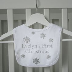 An elegant personalised bib for babies this Christmas that has been hand printed with a silver glitter finish.  A white bib made from 100% soft cotton with a velcro fastening. An elegant Christmas bib for both boys and girls.  Comes in one size. A variety of other matching Christmas bibs and babygrows are available in this range.  Made from: 100% cotton, Handprinted with a soft, washable vinyl. Can be washed at 40, iron on reverse of print.