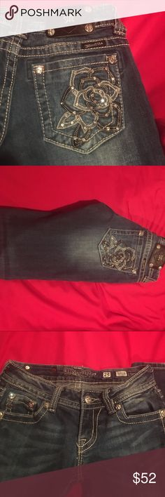 Miss Me Jeans Beautiful dark with light wash on front miss me jeans. Very gently used only worn a few times. They have no flaws.  Beautiful black and white rose embellishments on the pockets with rhinestones. Size 25 length 32 Miss Me Jeans Skinny