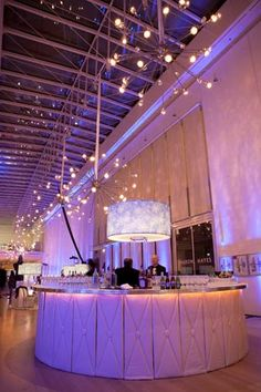 At a circular bar, guests could get spiked eggnog and other cocktails. #hmrdesigns #winter #celebrations