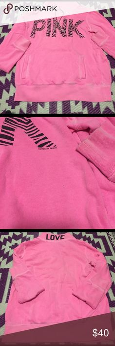 Victoria Secret Pink Bright Pink Quarter Zip Sz sm Good preowned condition Victoria Secret Pink bright pink quarter zip pullover with zebra print. Love written on back collar. Tiny whole pictured, which is so small that I didn't even notice it until I was taking pictures. Thanks for looking. PINK Victoria's Secret Tops Sweatshirts & Hoodies