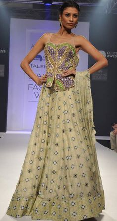Mirror work lehenga set by ARPITA MEHTA. Shop at http://www.perniaspopupshop.com/lakme-fashion-week/arpita-mehta/arpita-mehta-mirror-work-lehenga-set-aplfw081306.html