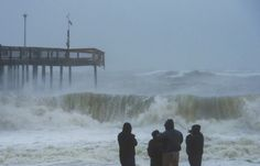 Oct. 28, 2012   Folks watch the massive waves from the effects of Hurricane Sandy in Ocean City, NJ