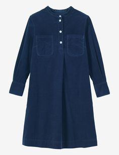 Collarless A-line tunic dress in a soft, light, needlecord. Four button opening, with pleat below. Two patch pockets. Two slip-in pockets. Bracelet length sleeves and double buttoned cuff. Box pleat into back yoke.