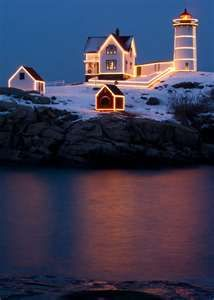 The Cape Neddick Lighthouse stands on Nubble Island about 100 yards m) off Cape Neddick Point. It is commonly known as Nubble Light or simply The Nubble. Cape Neddick Point is at the north end of Long Sands Beach in the village of York Beach. York Beach Maine, York Maine, Coastal Christmas, White Christmas, Christmas Time, Maine Lighthouses, Harbor Town, Pacific Coast, East Coast