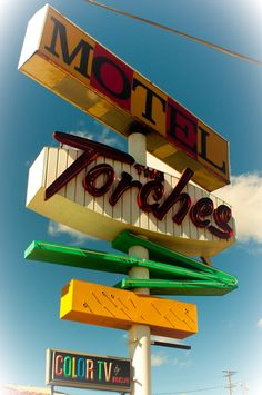 """""""The Torches"""" retro motel sign seen on the way to Las Vegas, Nevada."""