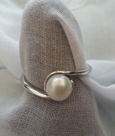 would make a lovely bridesmaid gift! Solid Sterling Silver Single Pearl Ring by EastWestBlends on Etsy, $25.00