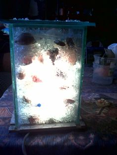 This lamp is made out of broken glass and shells