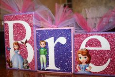 Great centerpiece  Could buy glitter paper & then use Silhouette to cut out letters and Sofia images (or print those images on clear velum and cut out square to go over block)