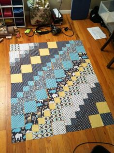 """Baby Elephant Walk quilt, a mixture of 5"""" squares and four patches, large and small scale prints."""