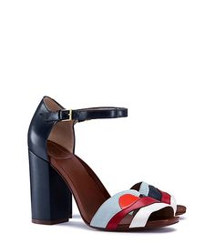 Our Miro Sandal delivers flattering height and an eclectic mix of materials in one striking sculptural design. Influenced by modern landscape paintings, a key theme of the season, this cut-out ankle-s