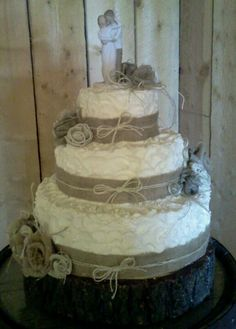 Buttercream wedding cake with burlap ribbon roses and twine accents.