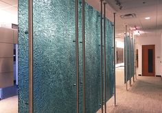 "Gaddis Research - Richardson, TX  Glass Description:  Partition / Divider Panels  3/8"" Azurlite Tempered Kiln-Fired Glass  Texture: MD231 Anime / Horizontal Pattern  Hardware Description:  2"" Diameter Stainless Steel Rods with Stand-Offs and Escutcheon Covers"