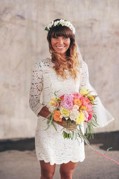 Pretty little lace wedding dress. My kind of dress! Love the pastel bouquet too.