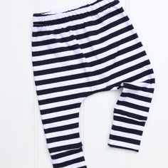 Baby Toddlers Leggings in fabric design Stripe 95% cotton 5% elastain * Öko-Tex Standard 100 * There are no organic versions of these fabrics  These Harem Pants are extremely comfortable due to the four way stretch of the fabric, the design allows plenty of room for nappies The pants also feature a ankle cuff which can be turned up and down to allow for growth!  I use only the highest quality fabric, which is gorgeously soft for little ones. All seams are overlocked inside, the waist band…