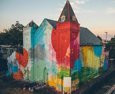 Alex Brewer Brightens Up Buildings, Churches and Underpasses With His Abstract Murals.