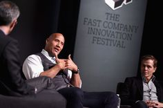 "Dwayne Johnson Photos Photos - (L-R) Robert Safian, Dwayne ""The Rock"" Johnson and Patrick Whitesell speak onstage during 'The Next Intersection For Hollywood with William Morris Endeavor's Ari Emanuel, Patrick Whitesell and Dwayne ""The Rock"" Johnson' at the Fast Company Innovation Festival on November 9, 2015 in New York City. - The Fast Company Innovation Festival - The Next Intersection for Hollywood with The Rock"
