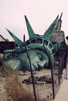 The statue of liberty head lying down perhaps the old one when going through restoration. However the architecture of the statue's head is very unique such as the fine strands of hair with the carved detailed lines.