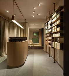Aesop's new Hamburg store by Vincent Van Duysen Architects features ladder-like shelving made from oak and blackened steel, and a large stone sink.