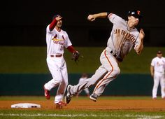 San Francisco Giants' Matt Duffy (50) rounds third base on his way to home plate to score the game tying run against the St. Louis Cardinals in the ninth inning of Game 2 of baseball's NL Championship Series at Busch Stadium in St. Louis, Mo., on Sunday, Oct. 12, 2014.  (Nhat V. Meyer/Bay Area News Group)