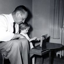 A father teaches his daughter to play on a Schoenhut (1944)