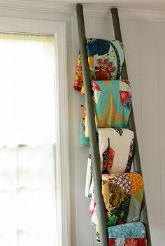 Use an old ladder to display quilts