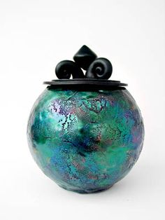 Polymer clay faux raku on glass by Syndee Holt. Love the colours!